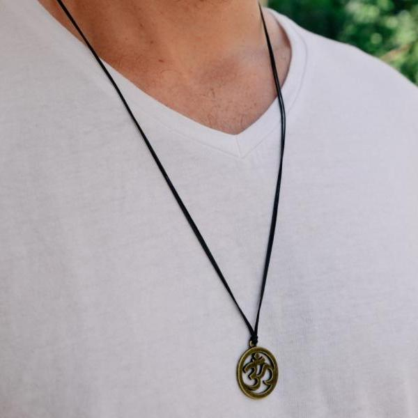 Men's necklace with a black cord and a bronze ohm pendant, Om necklace for men, groomsmen gift for him, men's jewelry, yoga jewelry, hindu